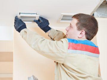 Technician Fixing Air Filter