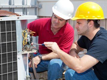 Two Technicians fixing generator