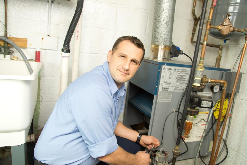 Heating technician working on wires