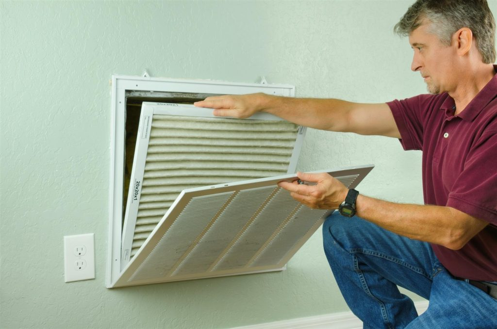 Man Opening Air Vent